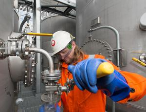 Veolia employee using machinery