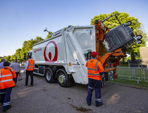 Veolia employees tipping bin waste into lorry