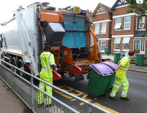 Two Veolia employees placing bins in lorry