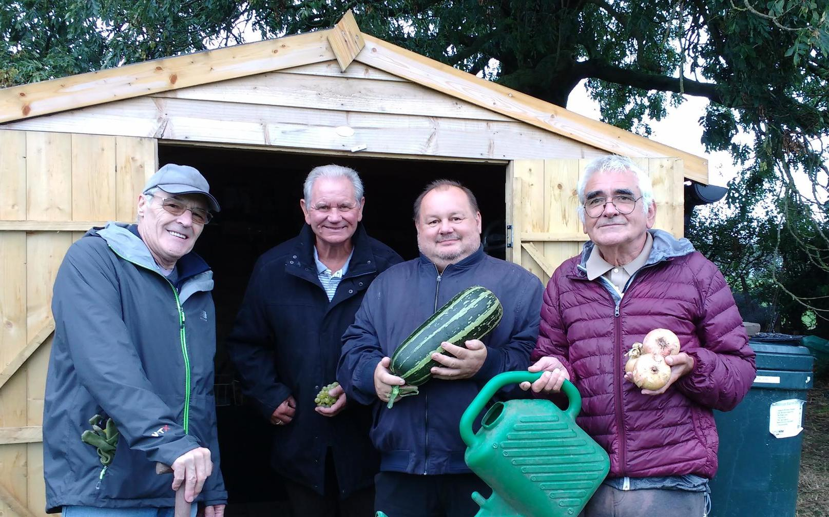 Photo of residents Mike Freeman, Tony Alvis, Cyril Chantry and Michael Skinner with their produce
